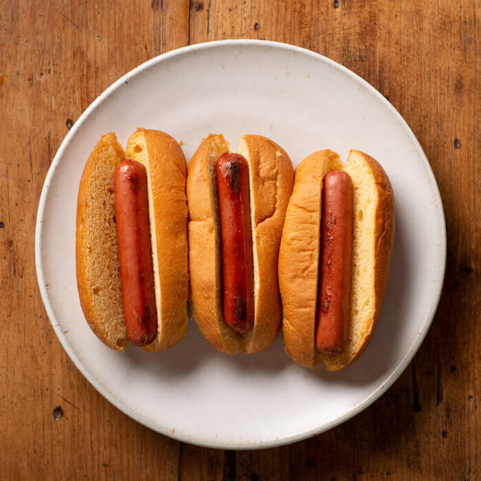 three hot dogs on a plate